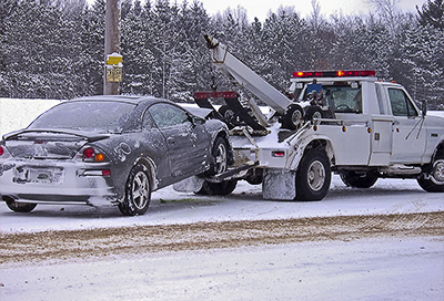 Car being towed in the winter